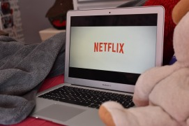 Watching Netflix on a laptop in bed